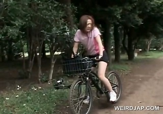 japanese teen hotty rides bike with a dildo up in